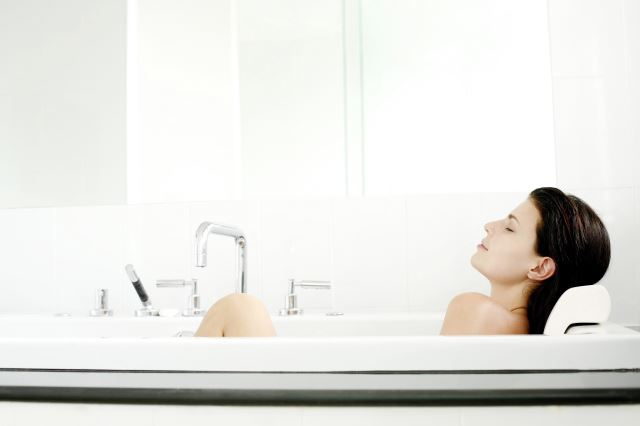 relaxing in a hot bath may help with a sore back