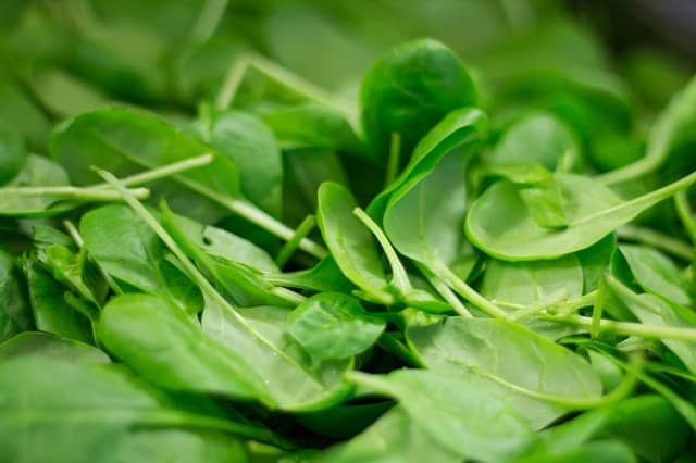 spinach will provide you with tons of magnesium, folic acid, and Vitamins A and C